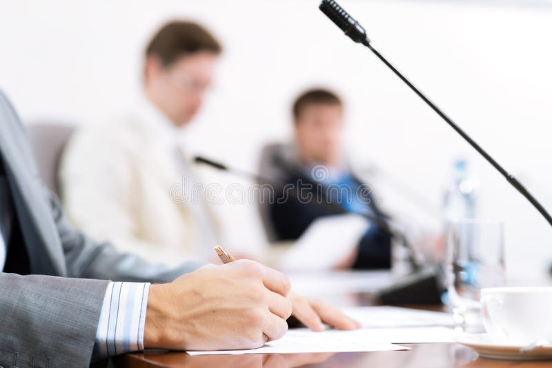 Businessman writing on paper notes royalty free stock photography