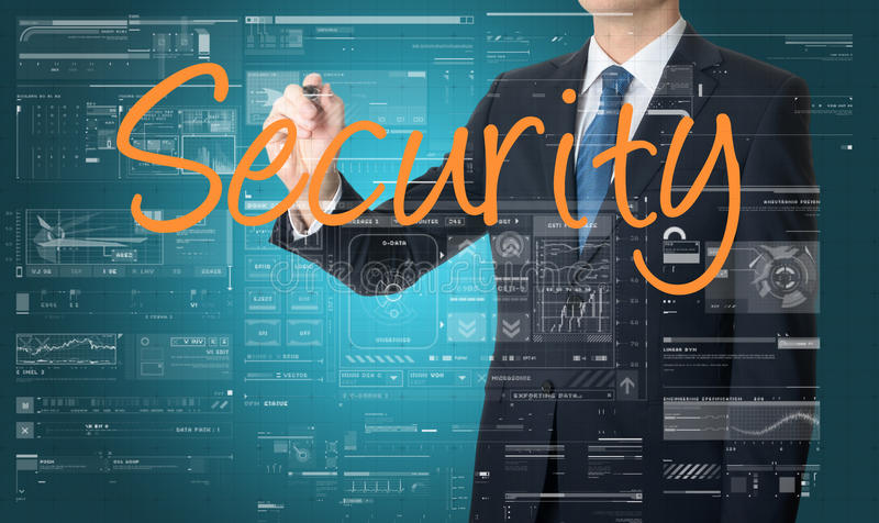 Businessman writing Security and drawing some sketches stock image