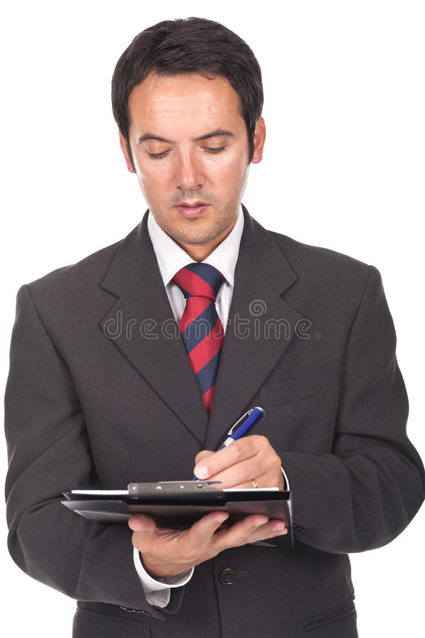 Businessman writing some documents royalty free stock photo