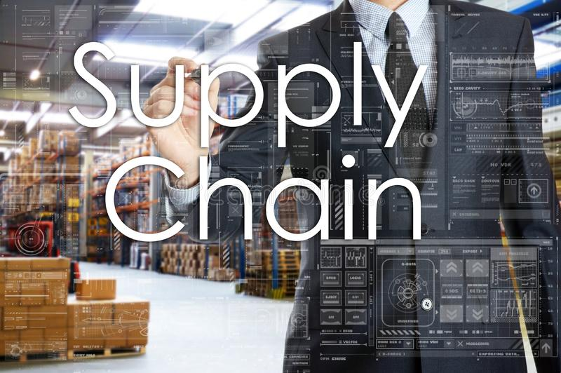 The businessman is writing things connected with the logistics i. N warehouse. Supply Chain stock images