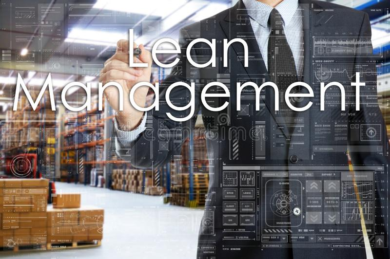 The businessman is writing things connected with the logistics i. N warehouse. Lean Management royalty free stock photo