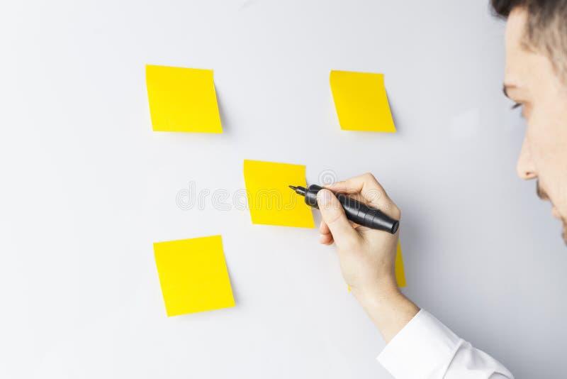 Businessman writing on whiteboard royalty free stock image