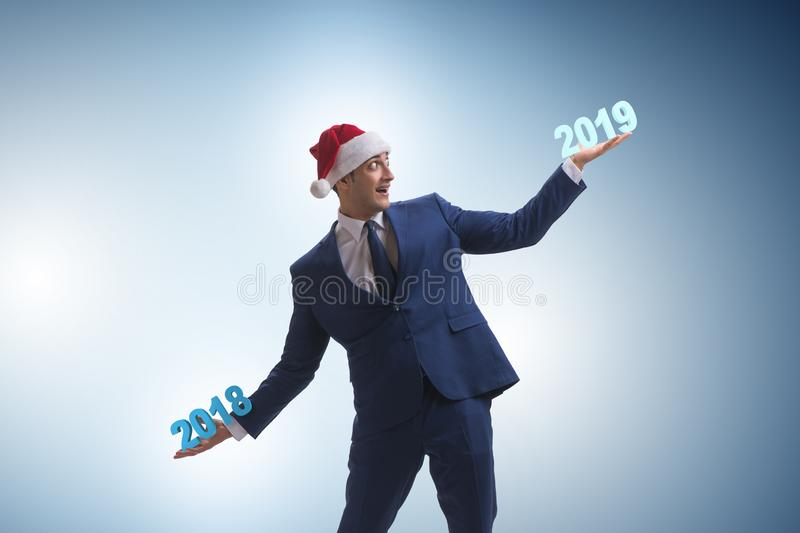 The businessman with 2018 and 2019 years royalty free stock photo