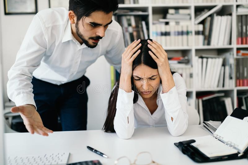 Businessman yelling at female colleague in office royalty free stock images