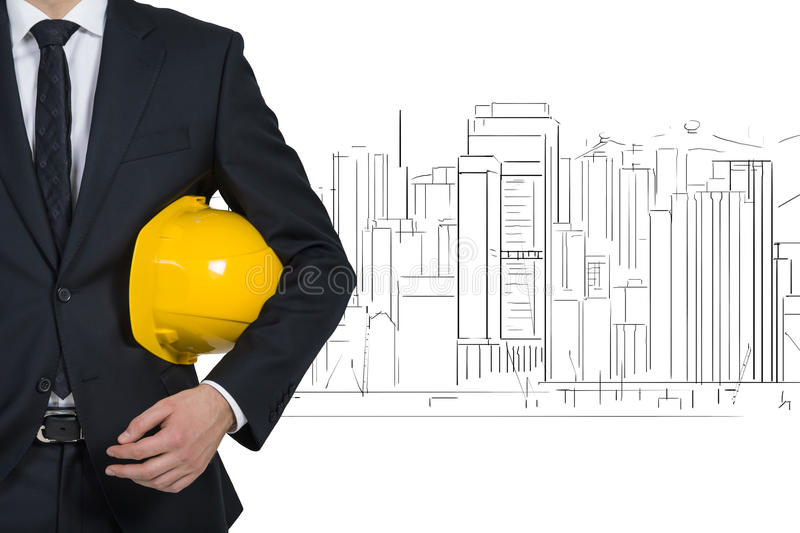 Businessman with yellow helmet. On drawing skyscraper background stock image