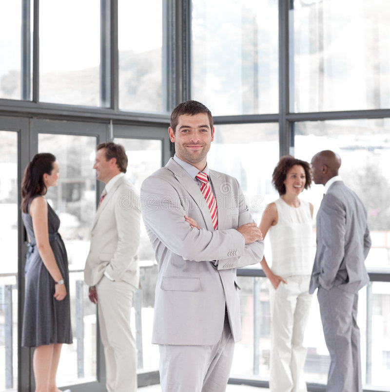 Businessmanager in front of his team royalty free stock photography