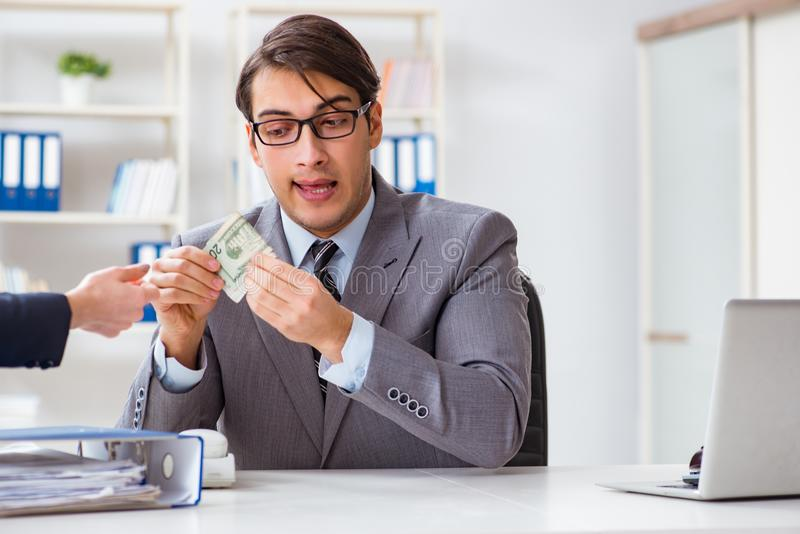 Businessmanbeing offered bribe for breaking law. Businessman being offered bribe for breaking law stock photo