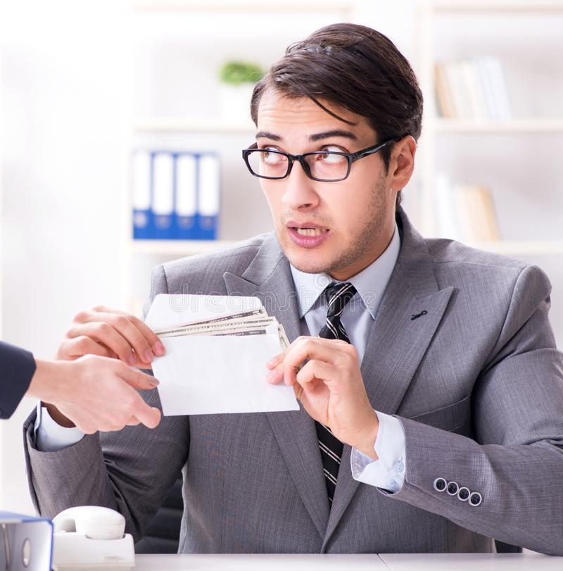 Businessmanbeing offered bribe for breaking law. The businessmanbeing offered bribe for breaking law royalty free stock photo