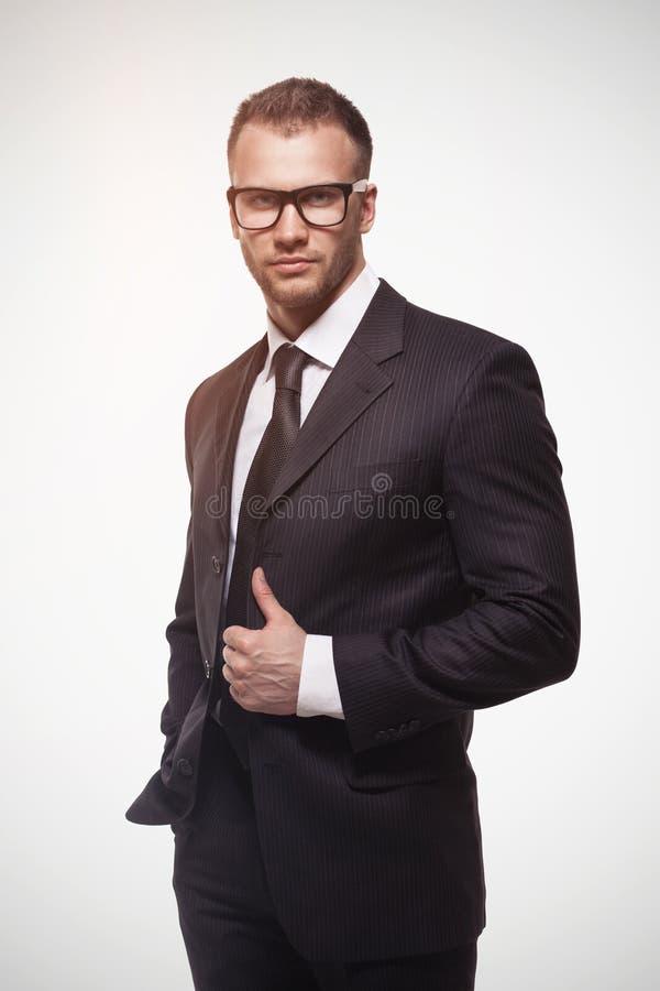 Businessmanman w czarnych szkłach i kostiumu fotografia royalty free