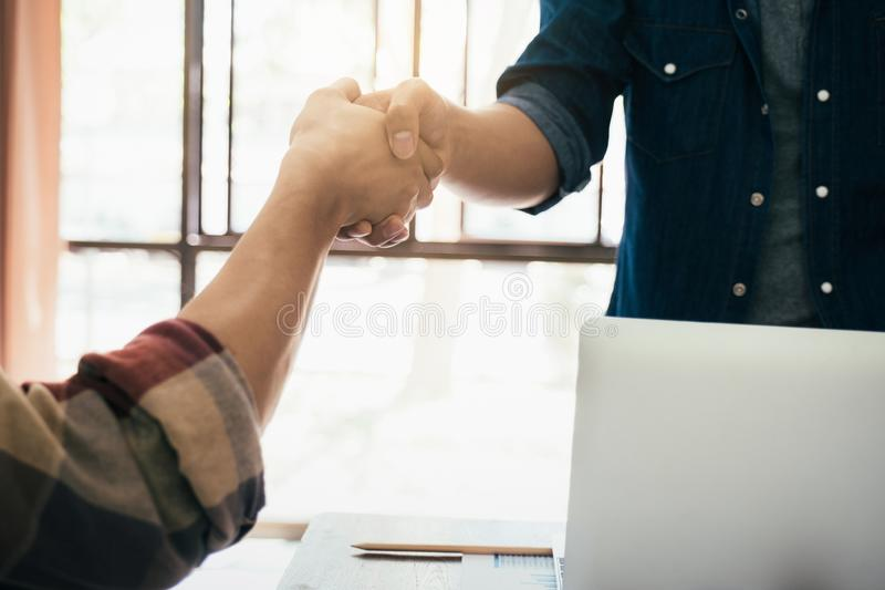 Businessmans handshake after good deal. Businessmans handshake. Successful businessmen handshaking after good deal. Business partnership meeting concept stock photos