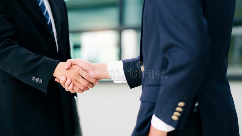 Businessmans handshake after good deal. Businessmans handshake. Successful businessmen handshaking after good deal. Business partnership meeting concept royalty free stock photography