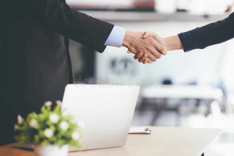 Businessmans handshake after good deal. Businessmans handshake. Successful businessmen handshaking after good deal. Business partnership meeting concept stock images