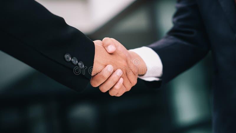 Businessmans handshake after good deal. Businessmans handshake. Successful businessmen handshaking after good deal. Business partnership meeting concept stock photo