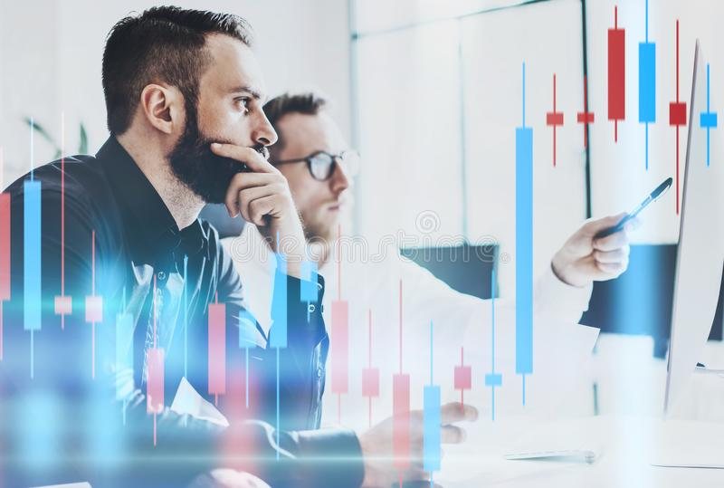 Businessmans looking on technical price graph and indicator, red and green candlestick chart and stock trading computer royalty free stock photos