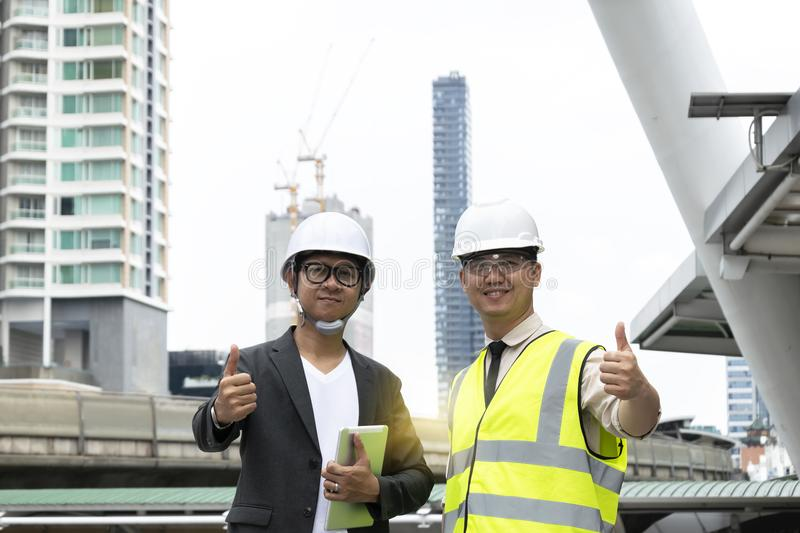 Businessmen agreed with the engineers. By lifting a thumb symbol stock photography
