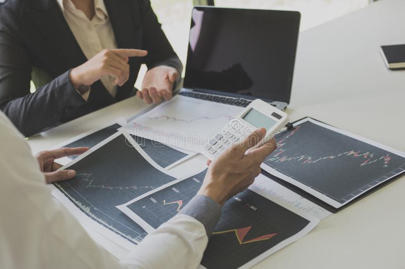 Businessmen are analyzing stock data, male company employees are discussing stock investment valuations, achieving business royalty free stock images