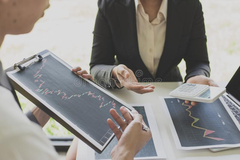 Businessmen are analyzing stock data, male company employees are discussing stock investment valuations, achieving business royalty free stock photo