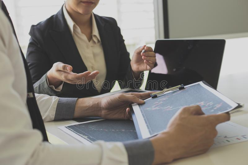 Businessmen are analyzing stock data, male company employees are discussing stock investment valuations, achieving business stock photography