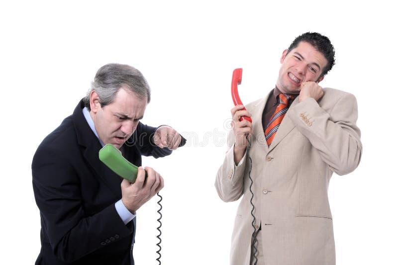 Businessmen arguing on the phone. Isolated on white - Studio shot stock image