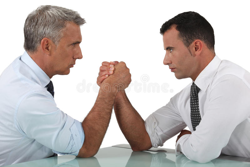 Businessmen arm wrestling. For a client royalty free stock images
