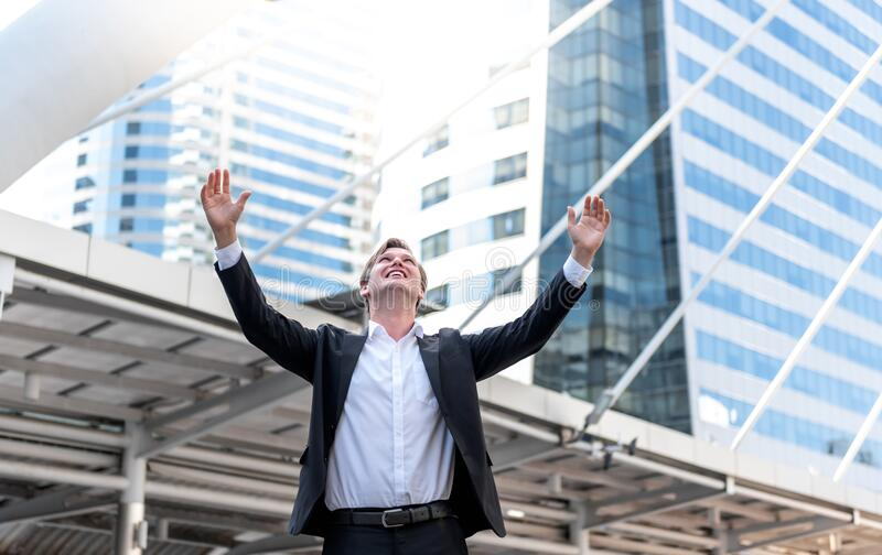 Businessmen With both hands raised above the head, Happy gesture From successful businesses. Caucasian male, businessmen With both hands raised above the head royalty free stock photo