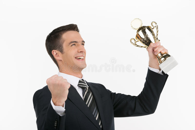 Businessmen with business trophy. royalty free stock photography