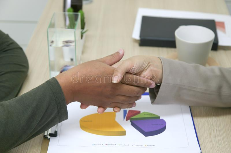 Businessmen and businesswomen shaking hands stock photos