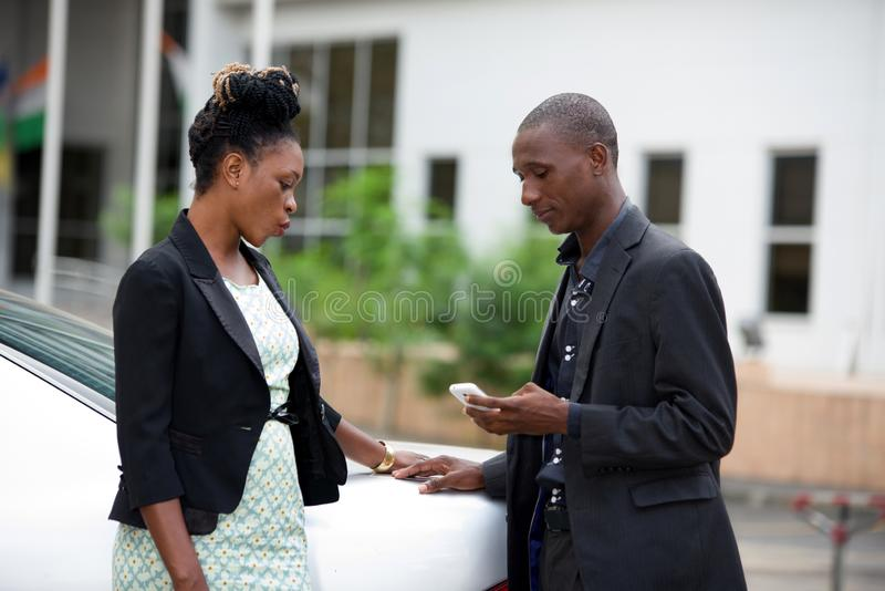 Businessmen and businesswomen talking outside stock photos