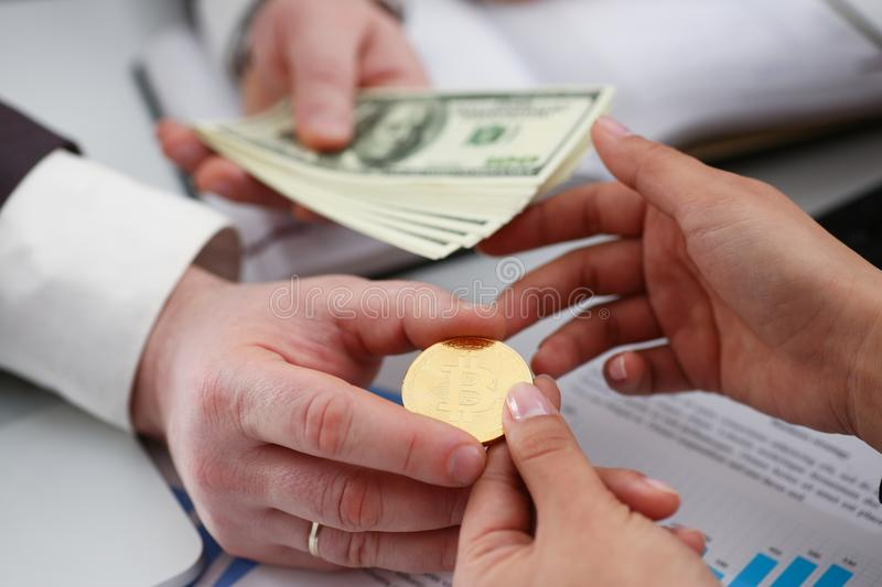 Businessmen change currency make successful deal hold money in arms. Wealth concept stock photography