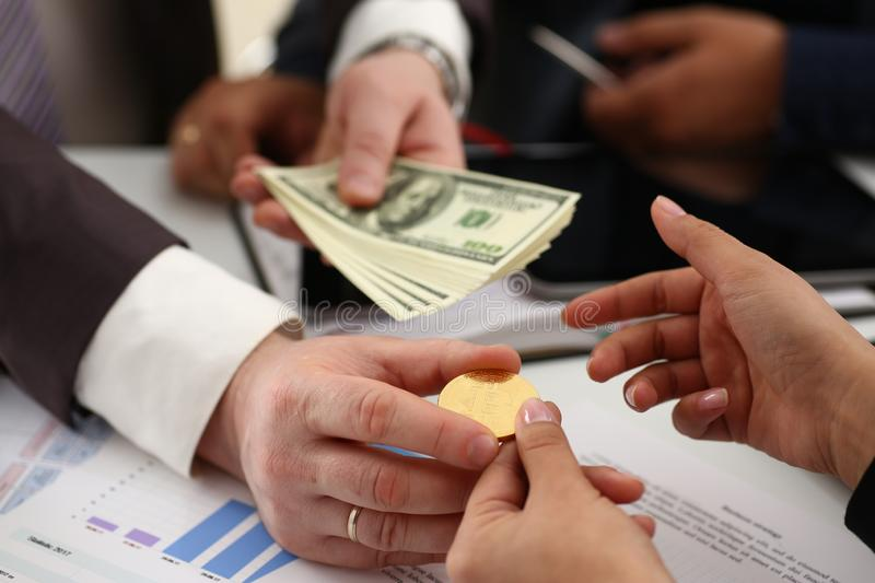 Businessmen change currency make successful deal hold money in arms. Wealth concept stock photo