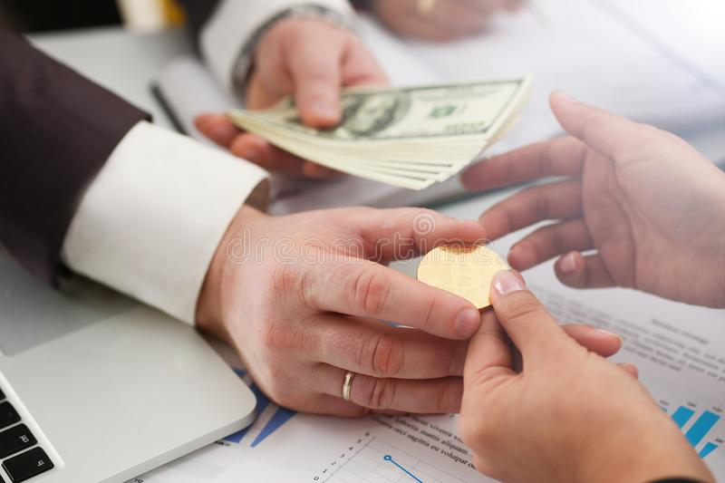 Businessmen change currency make successful deal hold money in arms. Wealth concept royalty free stock photography