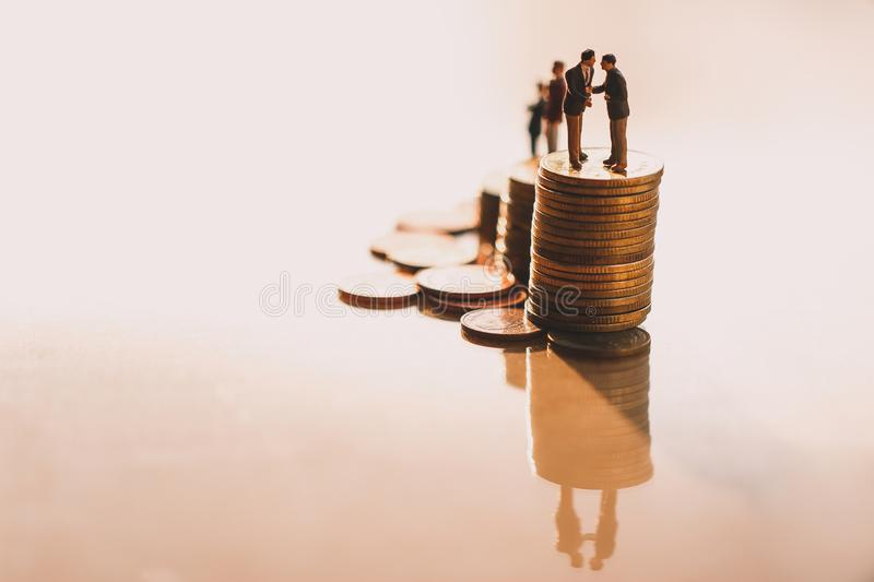 Businessmen checking hand on coins stacks. royalty free stock photos