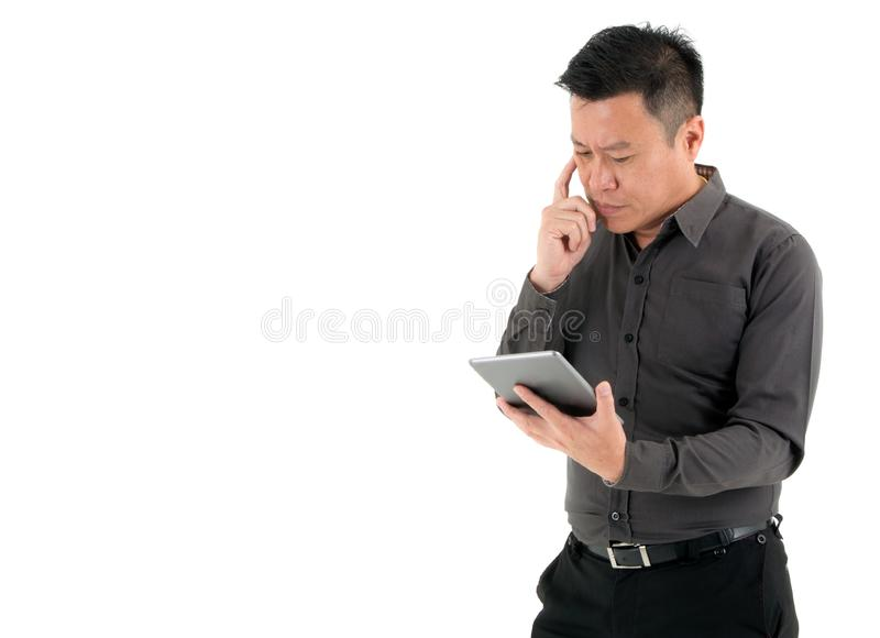 Businessmen concentrated to look on the digital tablet isolated on white background. Businessmen concentrated to look on the information on the digital tablet royalty free stock photo