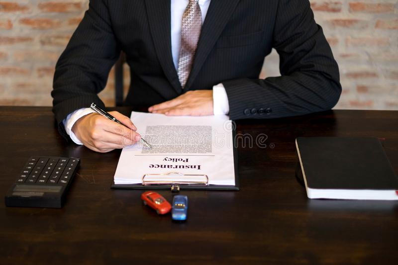 Businessmen contract on trading - rent a car. Businessmen insurance car concept. stock photos