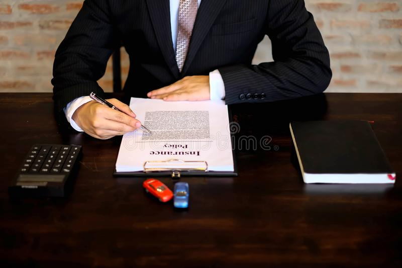 Businessmen contract on trading - rent a car. Businessmen insurance car concept.  stock photo
