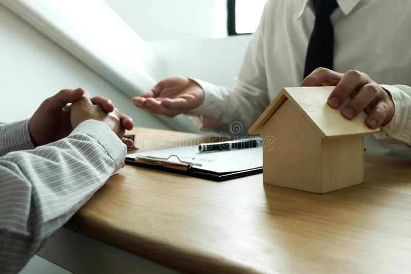 Businessmen contract on trading - rent a house. Businessmen insurance home. Business concept. royalty free stock photo