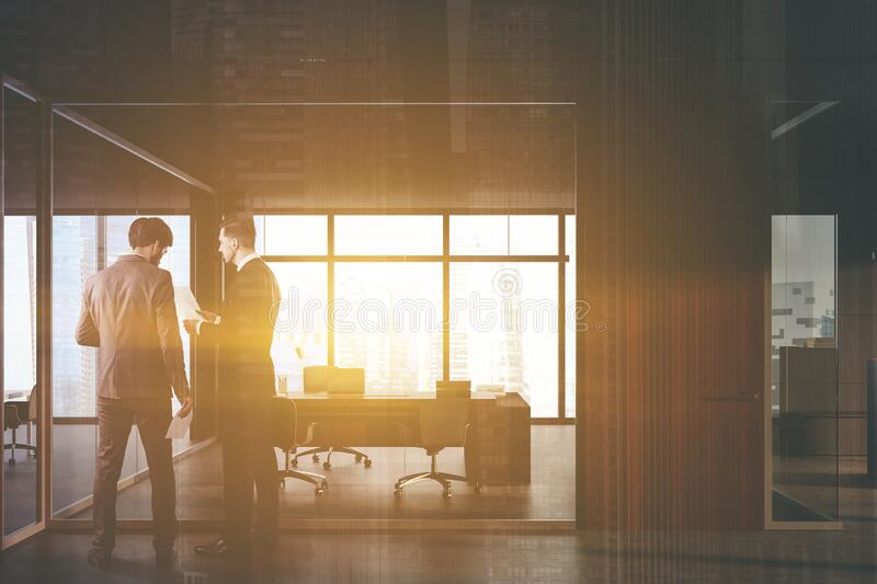 Businessmen in dark grey CEO office royalty free stock images