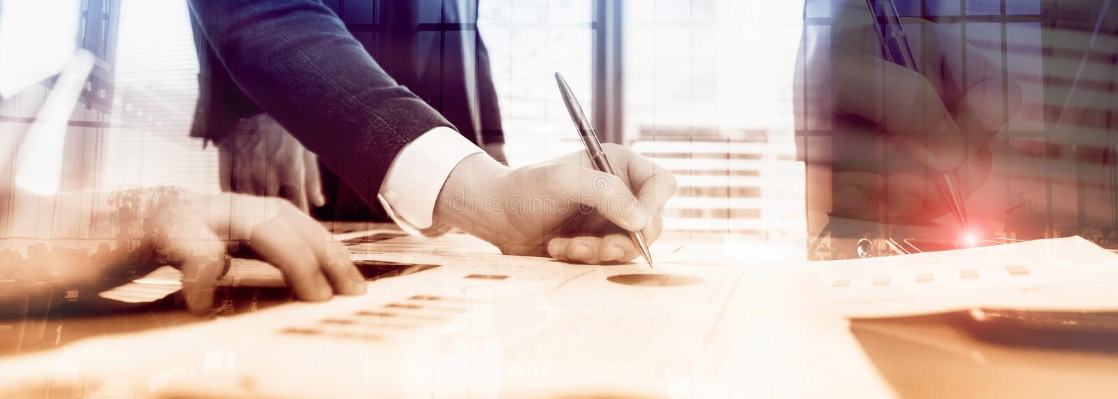 Businessmen discuss business. businessmen sign a contract royalty free stock photo