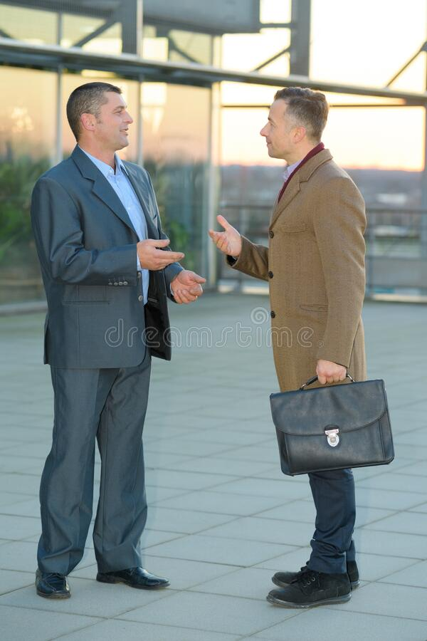 Businessmen in discussion outside work premises royalty free stock images