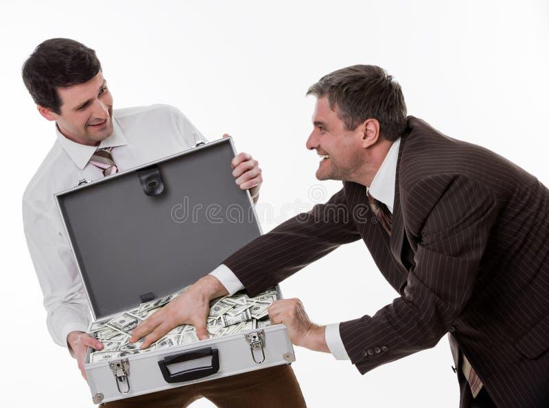 Businessmen divide profit. stock photography