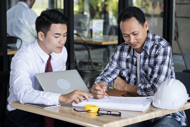 Businessmen and engineers were talking stock photos