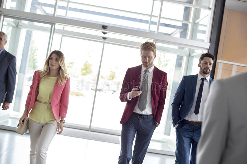 Businessmen enter in airport hall royalty free stock image