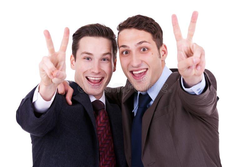 Businessmen gesturing victory stock image