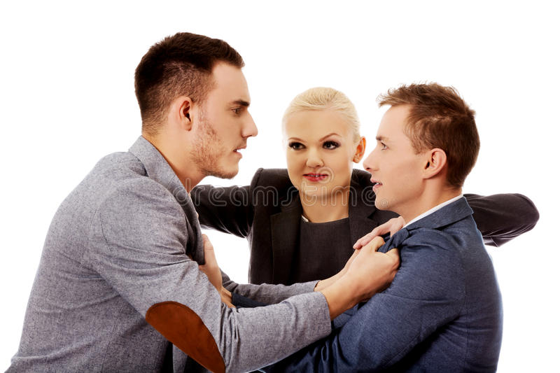 Businessmen getting into a fight woman trying to separate them royalty free stock photography