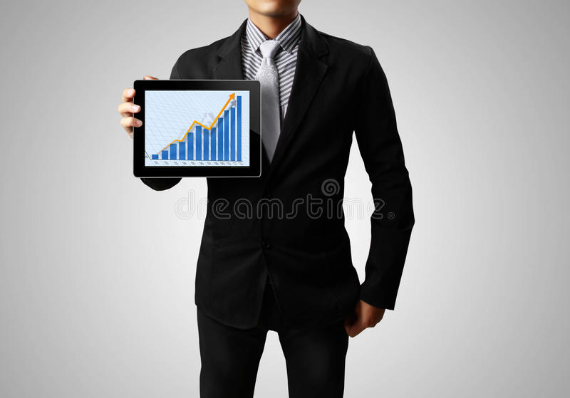Businessmen and ,graph on a tablet royalty free stock photos