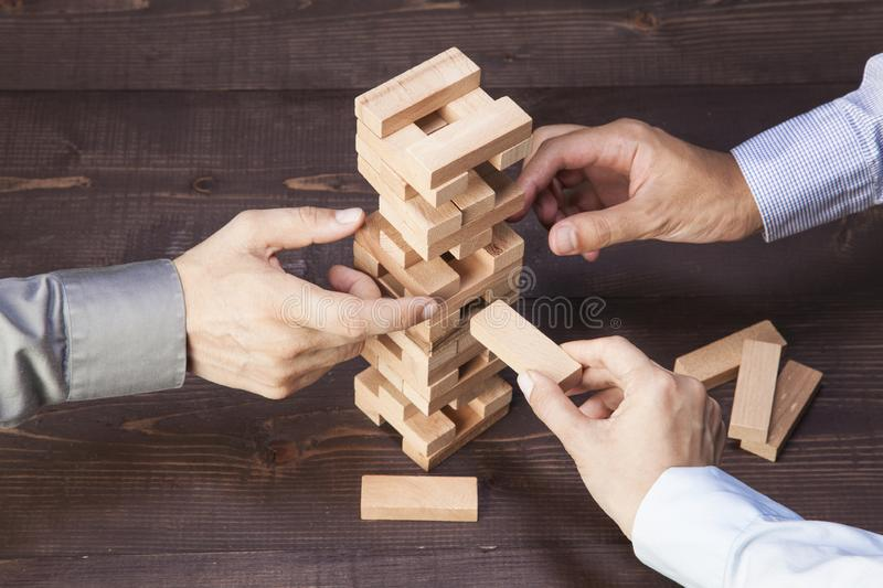 Businessmen Builds a Tower royalty free stock photos