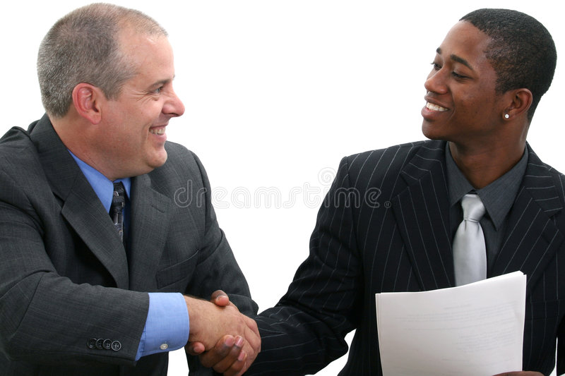 Businessmen Handshake. Two businessmen smiling and shaking hands. Shot in studio over white stock photo