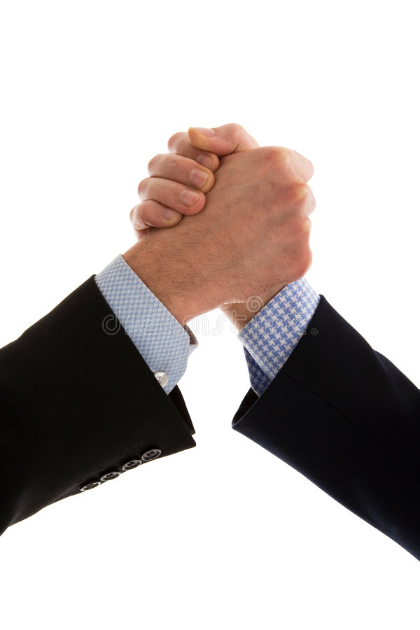 Businessmen handshake. Close up of friendly business people handshake. Dressed in dark and blue shirts stock images