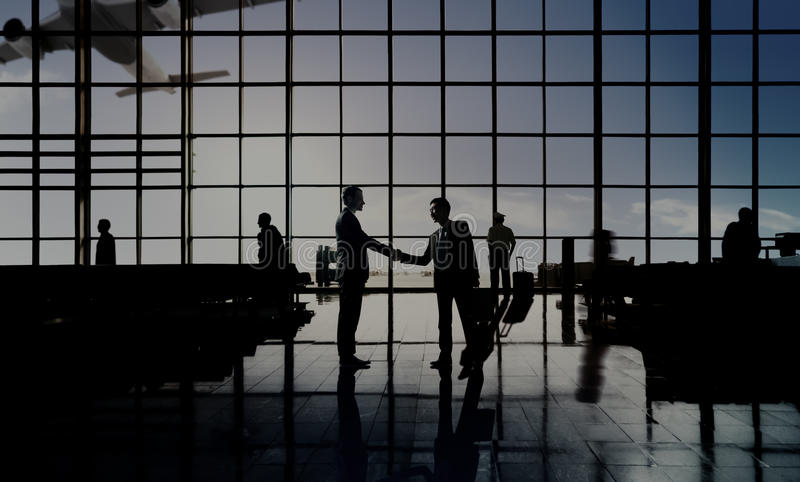 Businessmen Handshake Deal Airport Terminal Concept royalty free stock images