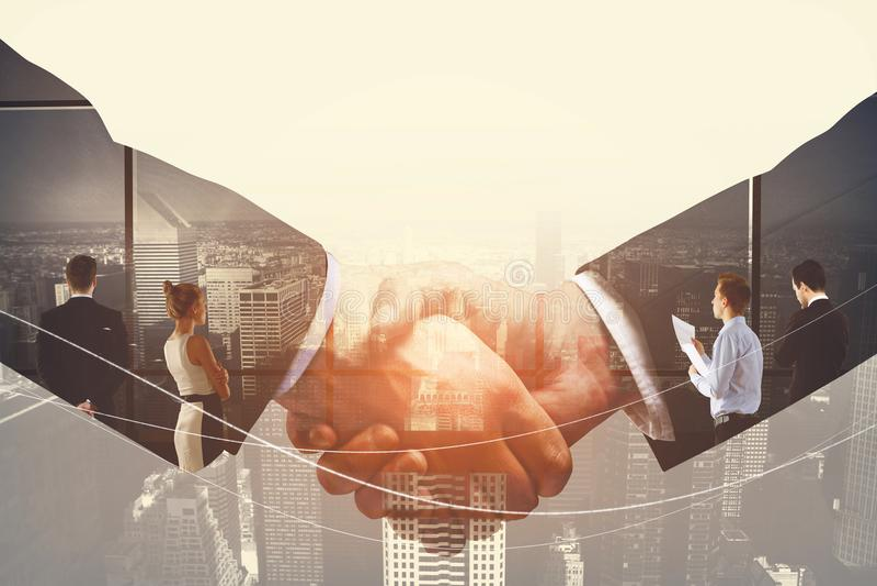 Businessmen handshake and team people stock image